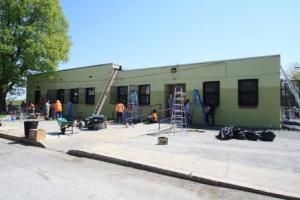 Rebuilding volunteers paint the rec